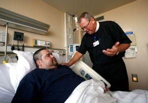 chaplain praying in hospital